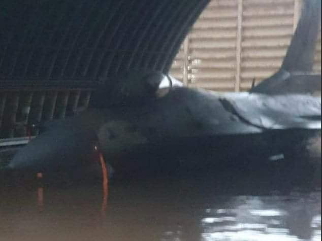 An Israeli F-16 sinking in floodwater.