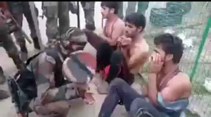 Indian army soldiers interrogate Kashmiri youth